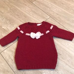 Red sparkling sweater dress with cream velvet bow